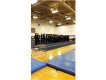 The Niles North program lining up before a home meet.