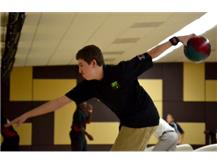 Team co-captain Avery Wolf displays steady form in his approach to another strike. (Photo courtesy of Rosalie Beirne.)