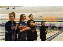 Bowlers Phoebe Rosa (3rd from left) and Gabby Potempa (far end) are introduced at the state sectional and are paired with three players from ETHS.