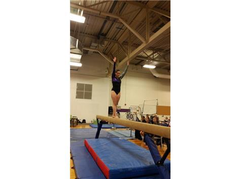 Sophomore Kyra VanDoren preparing for her jump tuck full on beam.
