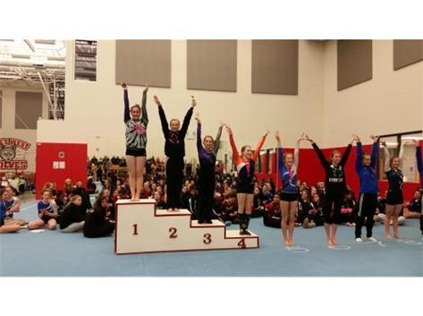Sophomore Kaylie VanDoren taking 1st place on uneven bars and Freshmen Athena Xidis taking 3rd.