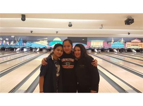 Niles North bowlers Phoebe Rosa and Gabby Potempa pose for a photo with fellow Niles West bowler Celina Tran (center) after they qualified for the state sectional.