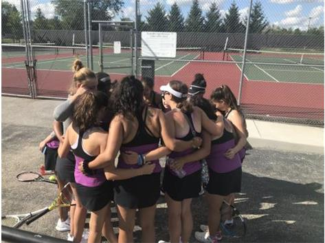 Team huddle before matches begin at York High School