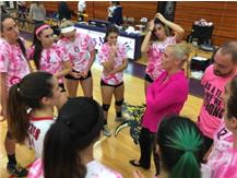 Coach Metoyer speaking to her squad after defeating Niles North.