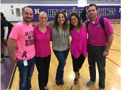 "NW & NN varsity coaching staffs with the recipient of the ""Cure for Breast Cancer"" game."