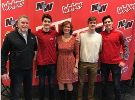 Brendan with his brothers, mom and dad.