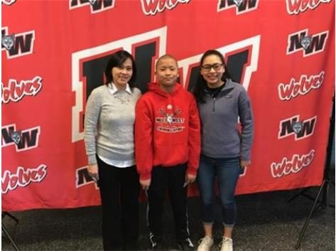 Kyle Avenir with his mom and sister.