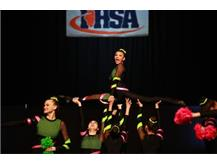 Brianna Khan, a member of the Varsity Pom Dance Team, is lifted by her teammates on the IHSA State Floor.