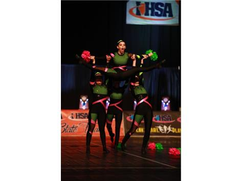 Addison Decker, a Freshman member of the Varsity Pom Dance Team, competes on the IHSA State Floor with her teammates Carly Vidovic, Maddie Fuscaldo, and Jorden White.