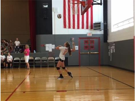 Lexi Ebert shows her strong serving against Forreston.