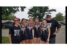The Girls 4x100 Relay of Rachel Barrett, Clista Hellwarth, Sydney Crouch and Ansley Burtch finished 2nd and qualified for the State Meet with a new school record of 50.46. Coach Barrett and Coach Cairns are also pictured.