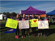 SOPHOMORE LAUREN MARVIN (CENTER) FINISHES 56TH IN STATE XC MEET