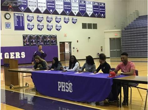 Tigers make it official signing NLI April 11, 2018. Congratulations! (l to r) Grace Luther-Kent St. (track), Adrian Crockwell-Oakland (basketball), Destinee McGrady-Indiana Tech, Dalajah Long-Ashland, Mckenzie Long-North Carolina St. (track), A.J. Thomas-Winston-Salem (baseball).