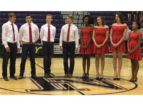 PHSN Theater students sing the National Anthem at Panther Madness