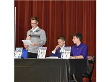 National Signing Day Evan Carden speaking.    Jake Farley and Jackson Ranck watching on
