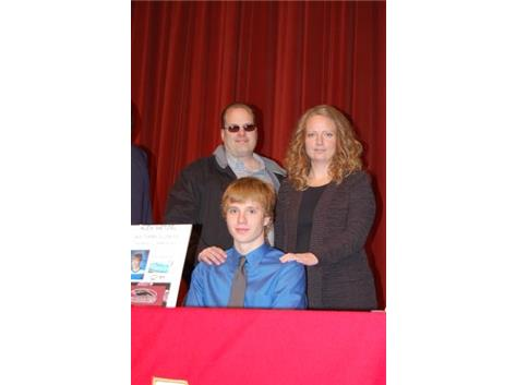 Alex Netzel and his parents at the National Signing Day assembly.