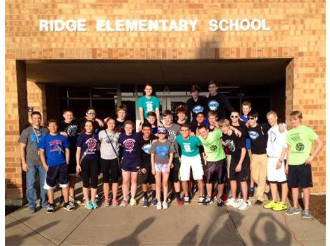 Coach Brian Zettergren and Plainfield South Volleyball volunteering at the Ridge Elementary Raptor Romp event fundraiser for a student fighting non-hodgkins lymphoma on 5/9/14