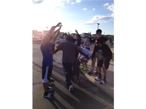The boys volleyball team cheering on finishers of the Ridge Raptor Romp Event 5/9/14