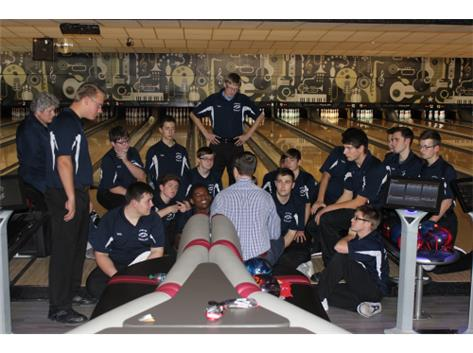 Coach Brian Zettergren, Coach Patti Schultz, and the bowling team during a match against Yorkville on 12/1/16