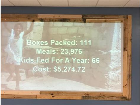 The boys bowling team helped to pack 111 boxes of meals to help feed 66 kids for an entire year.