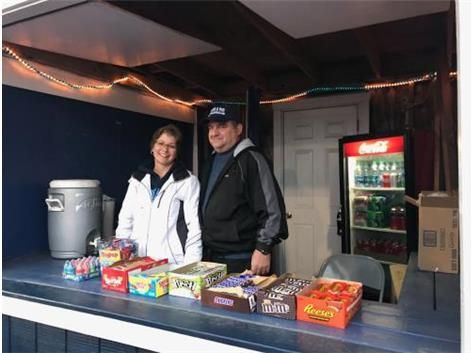 Mr. and Mrs. Gleim volunteering in the candy hut for a football game