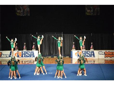 The Varsity cheerleaders perform heel stretches during their Finals performance at the 2014 IHSA State Championship.