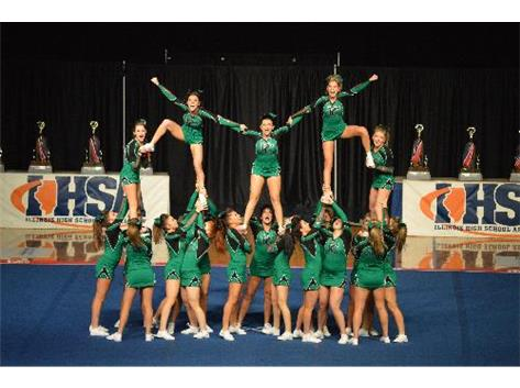 The Varsity Cheerleading Team hits one of their pyramid structures during their performance during Finals of the 2014 IHSA State Cheerleading Championship.