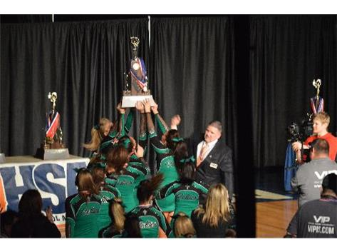 The Varsity Celtics claim their Third Place trophy at the 2014 IHSA State Cheerleading Championship.