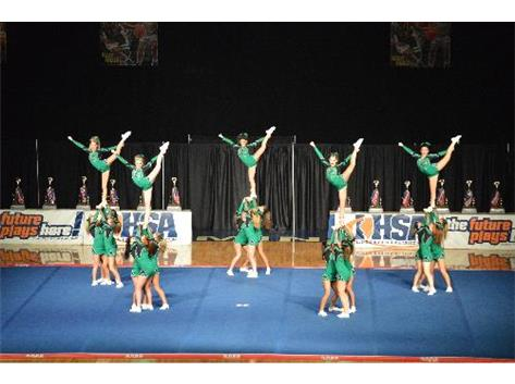 2014 Varsity Cheer Team executing beautiful flexibility and synchronization during their performance at the IHSA State Championship.