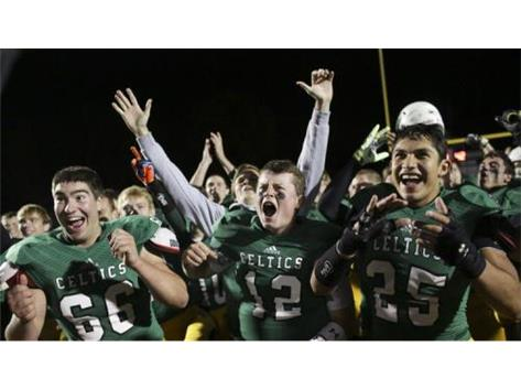 (Armando L. Sanchez / Chicago Tribune) From left, Providence senior Joe Zemen, senior Justin Hunniford and senior Luis Vasquez celebrate after defeating Brother Rice on Friday, Oct. 17, 2014.
