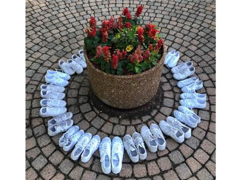 Blessing our shoes at the Grotto