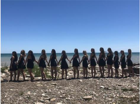 The Varsity GiGs taking beach photos before their first session at NCA Camp!