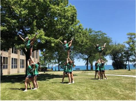 The Varsity team having a little fun outside stunting at NCA Camp!