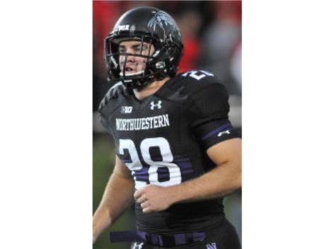 Alumni Tim Hanrahan awarded prestigious No. 1 Jersey by Northwestern University Head Coach Pat Fitzgerald.