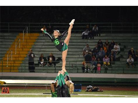 2013-14 Sophomore Carson Sineni performs during the Varsity Cheerleading team's half-time routine.