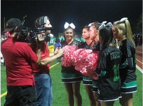 2013-14 The senior cheerleading captains get interviewed for Comcast's Battle of the Fans.