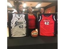 Former PW GBB Players (Khara Smith & Charlene Smith along with Dr. Thomas) honored by hanging their WNBA jerseys on the Panther Wall of Fame