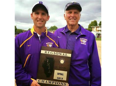 Coach Flesner & Coach Thomas holding the 2015 Regional Championship plaque.  The Eagles defeated Mahomet in dramatic fashion erasing a 5-1 deficit in the bottom of the 7th to win 6-5.
