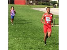 Allen Baylock surges past the competition during his second mile at the Pre-Conference meet