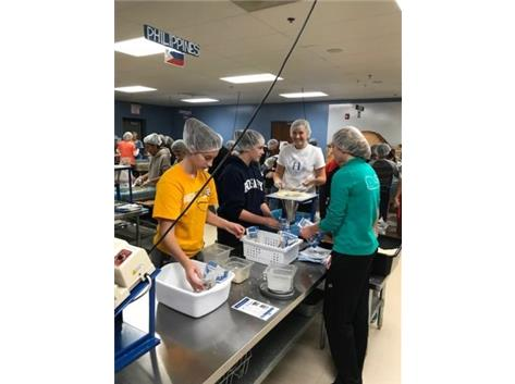 2017-18 Royals Basketball participating in Feed my Starving Children!