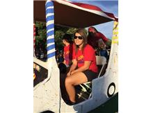 Girls built a golf cart float to win 3rd place Andrea and Sam are riding in the cart - the 2 Seniors