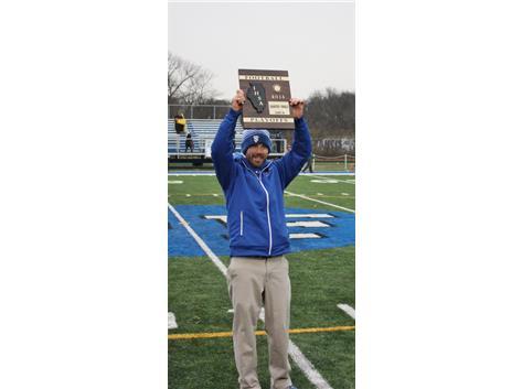 Coach Fitzgerald holds up 6A Quarterfinal plaque - picture taken by Matt Hart
