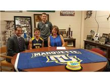 Stephen Poorten signs with Marquette University to run Track and Cross Country.