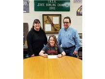 Amanda Swedberg signs with Blackburn College to play volleyball.