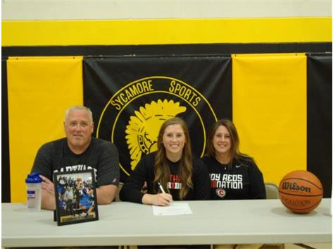 Bailey Gilbert signs with Carthage College to play Basketball.