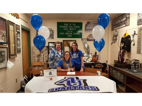 Cristen Nottinham signs with Aurora University to play softball.