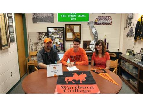 Bailey Hunt signing with Wartburg College to play football.