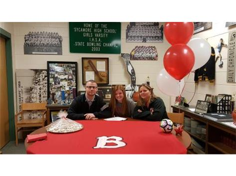 Cali Carl signing with Benedictine University to play soccer.