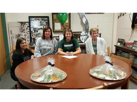 Madison Hunt signs with Kishwaukee College to play volleyball.