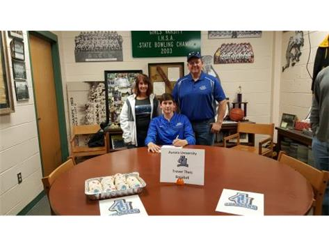 Trever Theis signs with Aurora University to play baseball.
